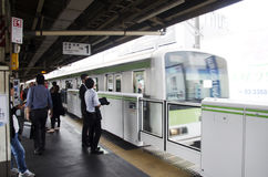 Japanese people and foreigner traveller waiting train and subway Stock Photo
