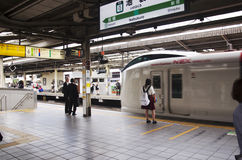 Japanese people and foreigner traveller waiting train and subway Royalty Free Stock Photo