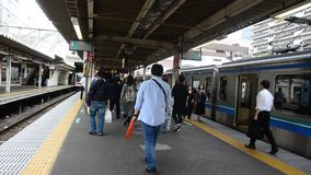 Japanese people and foreigner traveller walking go to train and subway at Nippori station stock footage