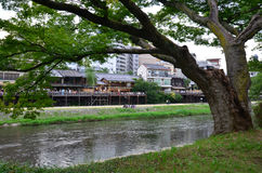 Japanese people relax and dinner at restaurant beside of Kamo Ri. Ver on July 11, 2015 in Kyoto, Japan stock photography