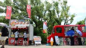 Japanese people selling takoyaki for traveler in car shop stock video footage