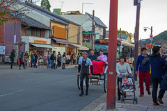 Japanese people take  rickshaw for sightseeing Arashiyama. KYOTO, JAPAN-NOVEMBER 12, 2015: Unidentified people with Traditional Japanese Kimono dress visit Stock Images