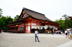 Japanese people and traveler foreigner walking inside Yasaka shrine for pray and looking visit at Yasaka shrine or Gion Shrine. On July 11, 2015 in Kyoto, Japan royalty free stock photos