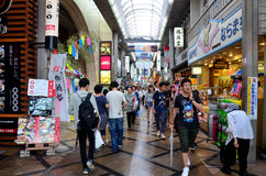 Japanese people and traveler foreigner walking at small alley in. Higashimuki Shopping Street for travel visit and shopping in Higashimuki market on July 7 stock photography