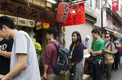Japanese people and travelers foreigner standing queue buy takoy Stock Photography