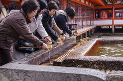 Japanese people washing hand in a temple Royalty Free Stock Images