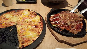 Japanese pizza. Wafu pizza and okonomiyaki Royalty Free Stock Images