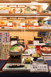 Japanese plastic food replicas in restaurant window Stock Photos
