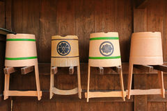 Japanese plastic and wooden bucket hanging on the wall Royalty Free Stock Photos