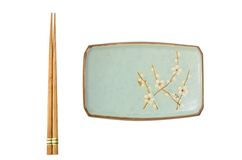 Japanese Plate and Chopsticks. An elegant japanese plate and a pair of chopsticks set for a left handed person Royalty Free Stock Photo