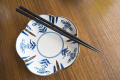Japanese plate and chopsticks Royalty Free Stock Photos