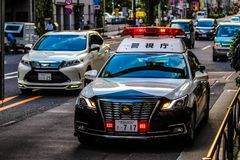 Japanese police car on a street of Tokyo. Japanese police car on a street in Tokyo stock photo
