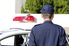 Japanese police officer with patrol car Royalty Free Stock Photography