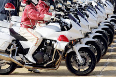 Japanese police woman on motorcycle Stock Image