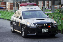 Japanese policemen people driving cop car on the road for check Royalty Free Stock Photography
