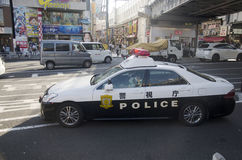 Japanese policemen people driving cop car on traffic road go to Stock Photo