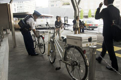 Japanese policemen people stopping bicycle after bike bicycles c Stock Images