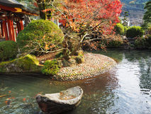 Japanese pond in garden Royalty Free Stock Image