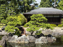 Japanese pond and traditional house Stock Photography