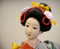 Japanese porcelain doll. In the traditional kimono Stock Image
