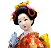 Japanese porcelain doll. In the traditional kimono isolated on white Stock Image