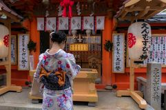 Japanese prayer in Kiyomizu temple. Beautiful Japanese woman in traditional clothes, wishes and prays in Kyomizu temple in Kyoto, Japan - November 7th, 2016 Stock Photography