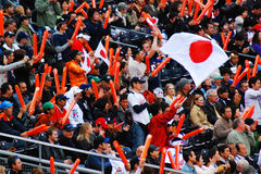 Japanese Pride. Fans of the Japanese Baseball Team cheer on the players Stock Image