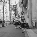 Japanese primary school students on a field trip. This black and white shot was taken in summer 2016 Stock Image