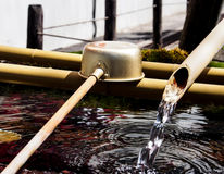 Japanese purification fountain and ladle Stock Image