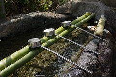 Japanese purification water and stainless ladles Stock Photo