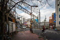 Japanese rail crossing in Tokyo. Rail crossing in Nishi-Nippori, a busy urban area in Tokyo royalty free stock photography