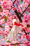 Japanese Rain Doll hanging on Sakura tree in outdoor garden Stock Photos