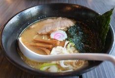 Japanese Ramen. With alga and pork in black dish Stock Photography