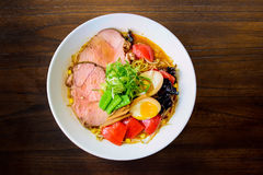 Japanese ramen noodles. With pork, eggs, broth, and vegetables stock photos