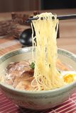 Japanese ramen noodles in soup. A japanese traditional noodles cuisine called ramen with boiled egg, braised pork in soy or pork soup Stock Photo