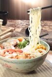 Japanese ramen noodles in soup. A japanese traditional noodles cuisine called ramen with boiled egg, braised pork in soy or pork soup Royalty Free Stock Photography