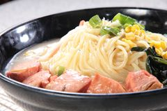 Japanese ramen noodles in soup. A japanese traditional noodles cuisine called ramen with boiled egg, braised pork in soy or pork soup Stock Photos