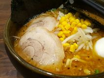 Japanese Ramen with pork slices, corns in thick broth. It consists of Chinese-style wheat noodles served in a meat or fish-based stock photo