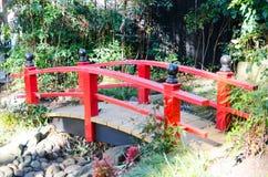 Japanese red bridge for garden decoration in Japanese garden style. A Japanese red bridge for garden decoration in Japanese garden style stock images