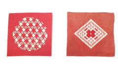 Japanese red and brown knitted coaster in white Royalty Free Stock Images
