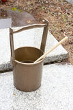 Japanese religous bucket and radle to  baptize. In the grave Stock Image