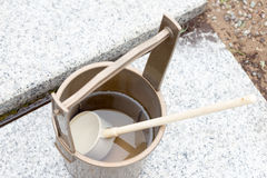 Japanese religous bucket and radle to  baptize. In the grave Stock Photos