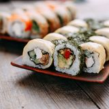 Sushi rolls with eel, salmon and cheese, close up Stock Photos