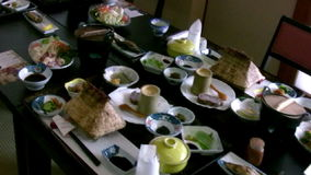 Japanese restaurant table. On the table in a Japanese restaurant - a lot of dishes of national cuisine Japanese stock video footage