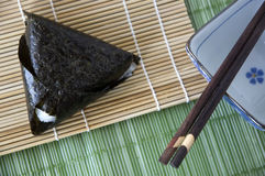 Japanese rice ball with chopstick Stock Image