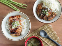 Japanese rice bowls: Grilled pork ribs and grilled chicken `Teriyaki` on rice with miso soup. Top view of Japanese rice bowls: Grilled pork ribs and grilled Royalty Free Stock Image