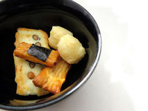 Japanese rice crackers in black bowl Stock Image
