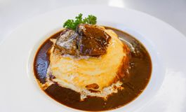 Japanese rice curry with omelette and beef. Golden Japanese Omelette Curry rice with beef Stock Photography