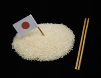 Japanese rice and japan flag on black background Stock Images