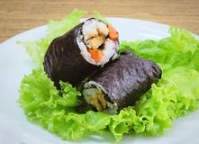 Japanese Rice Maki Sushi Roll Stuff with Tofu and Carrot. Japanese Cuisine, Traditional Vagetarian Japanese Rice Maki Sushi Roll Stuff with Tofu and Carrot Royalty Free Stock Images